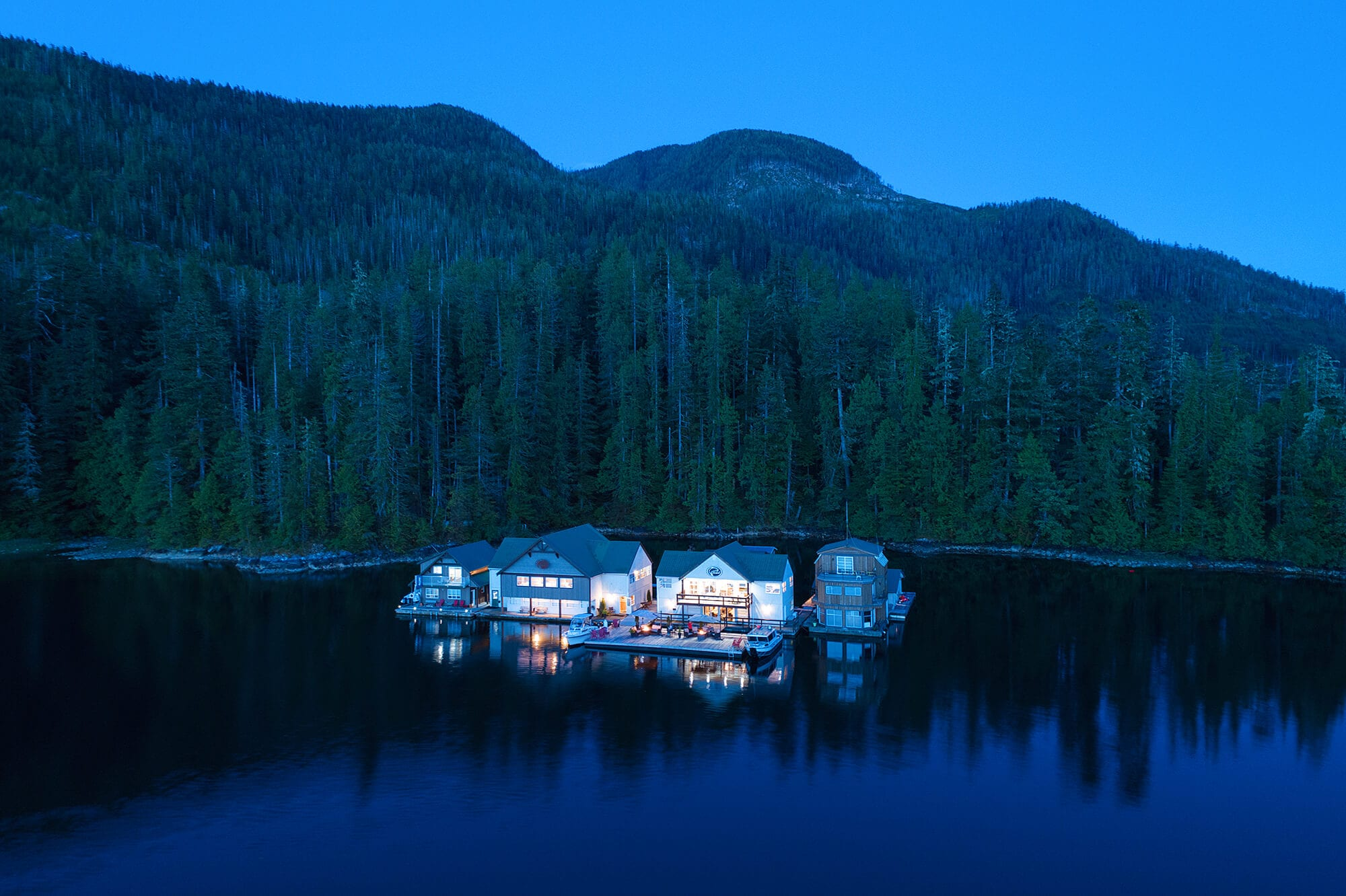 Aerial view of Nootka Wilderness Lodge at dusk.