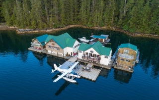 Aerial view of Nootka Wilderness Lodge with float plane parked at the dock.