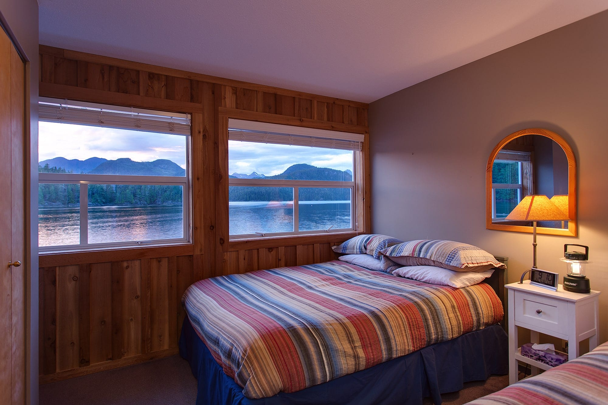 Nootka Wilderness lodge bedroom with view of lake and mountains.