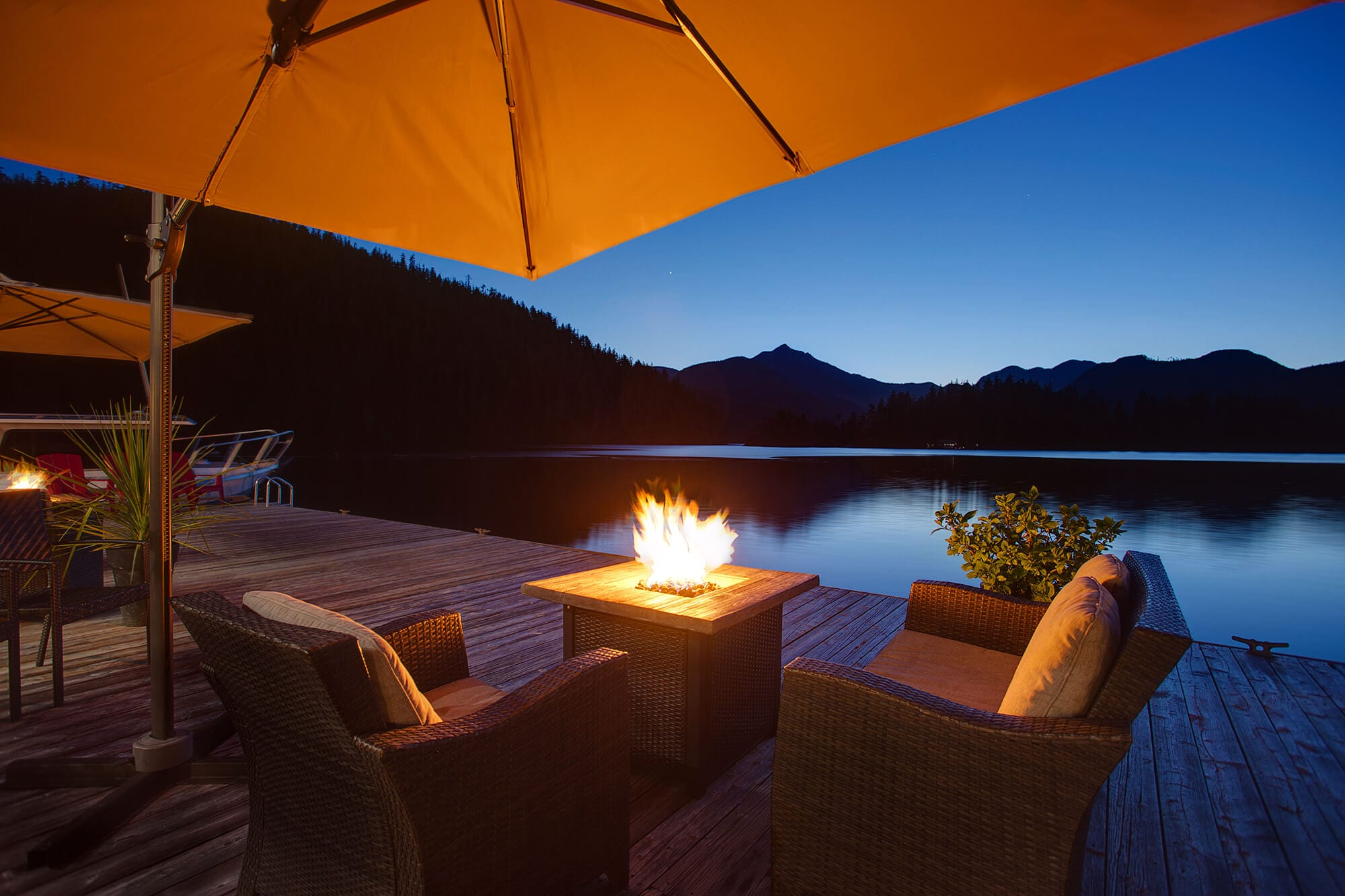 Patio furniture on boat dock at night.