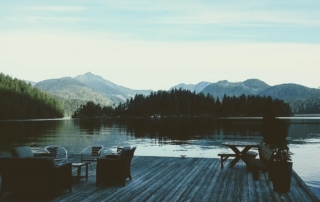 Nootka Wilderness Lodge dock with patio furniture.