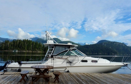 Fishing boat parked at Nootka Wilderness Lodge dock.