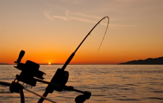 An elegant sunset seen from the back of a boat while on a BC fishing vacation near Vancouver Island.