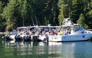 A row of boats perfectly situated for fishing on Vancouver Island.