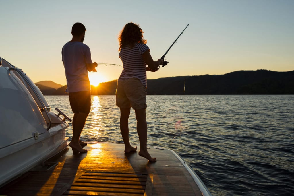 A couple sends casts off the end of a dock as the sun sets over the Nootka Sound during a romantic getaway on Vancouver Island.